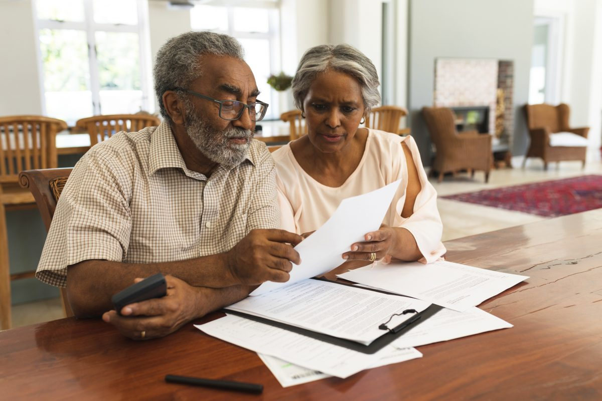 senior couple discussing over life planning documents