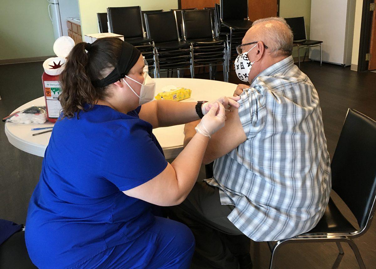 Pennsauken senior receives COVID-19 vaccine.